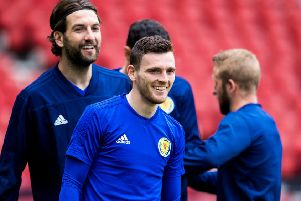 Scotland captain Andy Robertson,  training at Hampden, rapidly switched his focus after winning the Champions League with Liverpool. Picture: SNS.