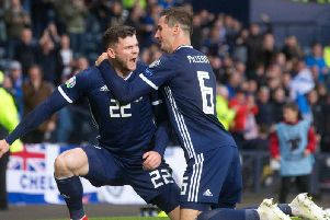 Oliver Burke celebrates his goal with Kenny McLean