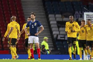 Charlie Mulgrew looks dejected as Scotland go down 4-0 to Belgium at Hmapden. Picture: SNS Group
