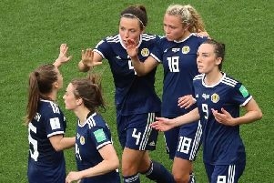 Claire Emslie (No.18) is congratulated by her team-mates after scoring Scotland's goal
