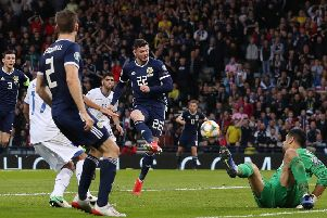 Super-sub Oliver Burke side-foots the ball into the net to give Scotland a 2-1 Euro 2020 qualifying win over Cyprus. Picture: Getty.