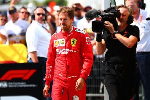 Sebastian Vettal storms into parc ferm� to swap the first and second place boards on the cars. Picture: Dan Istitene/Getty
