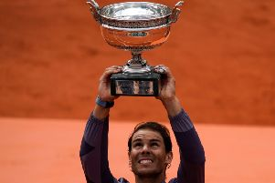 Rafael Nadal hoists the Coupe Des Mousquetaires for the 12th time at Roland Garros on Sunday. Picture: Kenzo Tribouillard/AFP/Getty