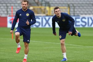 Scotland winger Ryan Fraser, left, and full-back Andy Robertson limber up for a training session at the King Baudouin Stadium. Picture: Virginie Lefour/AFP/Getty Images
