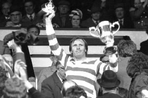 Celtic captain Billy McNeill lifts the Scottish Cup in 1974