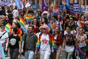 People take part in Pride Glasgow, Scotland's lesbian, gay, bisexual, transgender and intersex (LGBTI) pride event in Glasgow