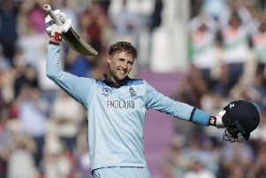 Joe Root celebrates reaching his second century of the tournament as England eased to an eight-wicket victory over the West Indies. Picture: AP.