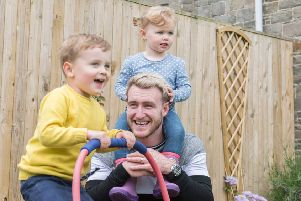 Scotland rugby star Stuart Hogg at home in Hawick with three year old Archie and two year old Olivia. Picture: George Powell