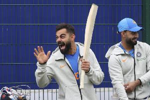 Captain Virat Kohli enjoys India's training session at Old Trafford in Manchester.  Photograph: Aijaz Rahi/AP