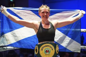 Hannah Rankin with the Saltire and the precious belt she won in Paisley on Saturday. Picture: SNS.