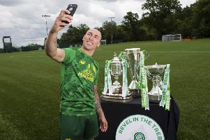 Celtic captain Scott Brown celebrated the club's historic treble treble. Picture: Paul Devlin/SNS