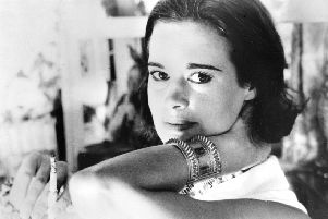 """Railroad heiress Gloria Vanderbilt poses for a photograph. Vanderbilt, the intrepid heiress, artist and romantic who began her extraordinary life as the """"poor little rich girl"""" of the Great Depression, survived family tragedy and multiple marriages and reigned during the 1970s and '80s as a designer jeans pioneer, died Monday, June 17, 2019,  at the age of 95.  (AP Photo, File)"""