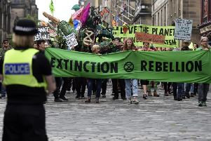 Climate change activists during Monday's march down the Royal Mile.