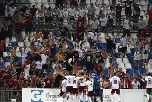 Sarajevo players celebrate a goal in front of their fans in a 2-2 Europa League draw with Atalanta in Italy last year
