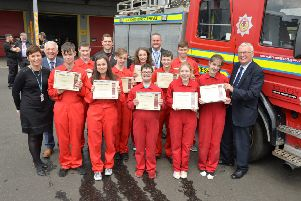 North Lanarkshire Council leader Jim Logue (right) hands out the Fireskills awards to pupils from Glencryan Primary