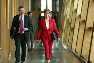 Derek Mackay, left, warned that recent growth in the Scottish economy could be undone by Brexit