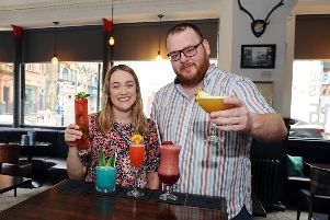 Claire Macdonald, Starthcarron Hospice's business development fundraiser, and Richard Hoehle, general manager of High Spirits, promote the launch of the bar's summer cocktail menu