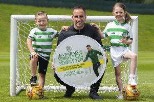 Celtic assistant manager John Kennedy ) promotes the club's summer soccer schools with Max Murray (aged 5, left) and Orla Currie (aged 7).