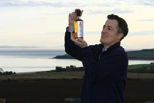 Iain Stirling with a bottle of the Arbikie Highland Rye. Picture: submitted