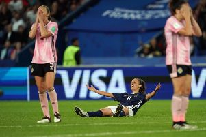 Argentina's forward Florencia Bonsegundo celebrates and it's agony for the Scots. Picture: Lionel Bonaventure/ AFP/Getty Images