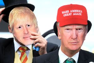 The global illiberal elite? Racegoers at Royal Ascot wear masks of Boris Johnson and Donald Trump (Picture: Adam Davy/PA)