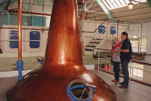 Visits to distilleries are up.  (AP Photo/Fred Seelig)