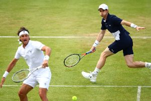 Andy Murray moved freely on court as he teamed up with Feliciano Lopez to beat Colombia's Juan Sebastian Cabal and Robert Farah. Picture: Getty.