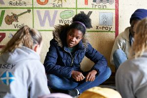 Sandra Ndale, right, a resident of the Steka care home, takes part in a 'dialogue group' with Scots teenagers (Picture David Aveyard, www.davidaveyard.co.uk)