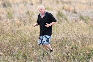 Boris Johnson goes for a jog in what was interpreted as a sly dig at Theresa May's 'field of wheat' anecdote