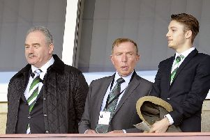 Sir Tom Farmer, centre, with Rod Petrie, at Hampden in 2015. Picture: Michael Gillen