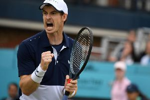 Andy Murray celebrates a point in the doubles final at Queen's. Picture: Getty Images