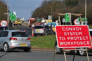 Road workers have warned of numerous 'near misses' due to drivers entering roadwork areas.