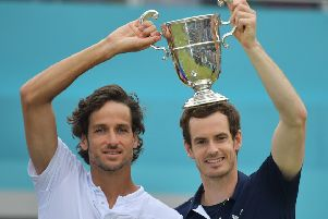 Andy Murray, right, and Feliciano Lopez celebrate their doubles win at Queen's Club. Picture: AFP/Getty Images
