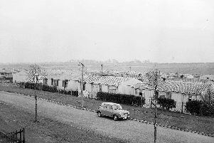 Prefabs sprung up all over Scotland to meet the housing crisis that took root during World War Two. Pictured are the homes in Southhouse, Edinburgh, in the early 1970s.'PIC: TSPL.