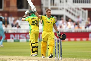 Australia's Aaron Finch celebrates reaching his century. Picture: Tim Goode/PA Wire