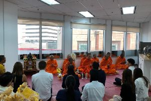 The Bangkok branch of Cathcart Associates receives a traditional Thai blessing, said to bring good luck and prosperity. Picture: Contributed