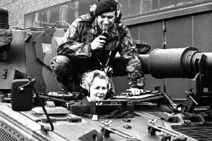 "This picture taken on January 23, 1976 shows Margaret Thatcher, then chairwoman of the British Conservative Party, and lieutnant Parradine sitting on a tank of the 7th regiment of the Royal Signals in Herford, western Germany. Margaret Thatcher, the ""Iron Lady"" who shaped a generation of British politics, died following a stroke on April 8, 2013 at the age of 87, her spokesman said.      AFP PHOTO / GERMANY OUT        (Photo credit should read -/AFP/Getty Images)"