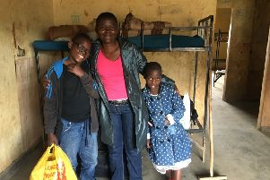 Private school pupil Bill (left) with his mother Debra and his little sister Eliza, settles into his dormitory (Picture: Susan Dalgety)