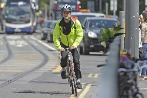 Two cyclists have won landmark damages claims after suffering injuries on the Capital's tram line.