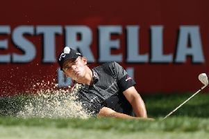 Christiaan Bezuidenhout plays out of a bunker at Valderrama. Picture: Luke Walker/Getty