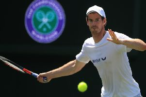 Andy Murray, on the practice courts at the All England Club, will team up with Pierre-Hugues Herbert in the men's doubles. Picture: PA.