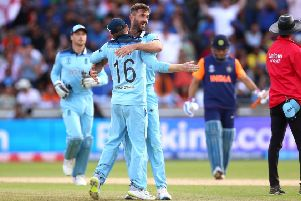 England's Liam Plunkett (right) celebrates taking the wicket of India's Hardik Pandya during the World Cup group stage match against India at Edgbaston on Sunday. Picture: PA.