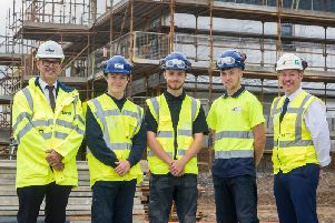 Construction director Neil Thomson (left) on site with workers from Stewart Milne Homes North. Picture: Contributed