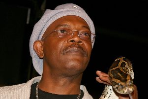 A possible climate emergency measure? Samuel L Jackson holds a snake ahead of the premiere of the film Snakes On A Plane. Picture: Kevin Winter/Getty Images