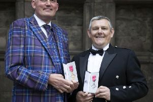 Former Scotland Rugby international and Motor Neurone campaigner Doddie Weir (left) after receiving his OBE and Tourette's Syndrome campaigner John Davidson after receiving his MBE from Queen Elizabeth II