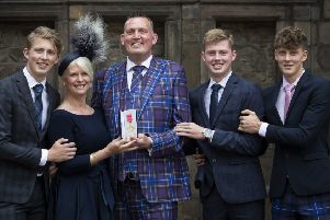 Former Scotland rugby international and motor neurone disease campaigner Doddie Weir, with wife Kathy and their three sons (from left) Hamish, Ben and Angus, after receiving his OBE from Queen Elizabeth (Picture: Jane Barlow/PA Wire)