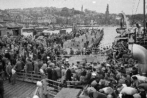 Crowds of holidaymakers coming ashore at Rothesay pier on July 17, 1956 for the Glasgow Fair holiday. (Picture: TSPL)