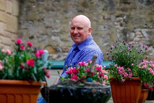 Eamonn Bannon in the garden of his guesthouse. Picture: Scott Louden