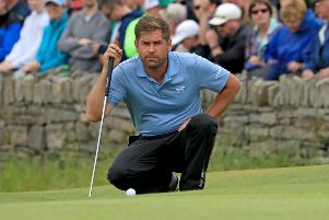 Robert Rock lines up his putt for a round of 59 in the Irish Open. Picture: Donall Farmer/PA Wire