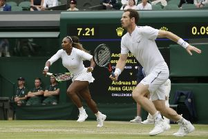 Serena Williams and Andy Murray race towards the ball. Picture: Tim Ireland/AP